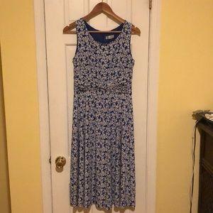 Dark blue dress with white like daisies flowers.